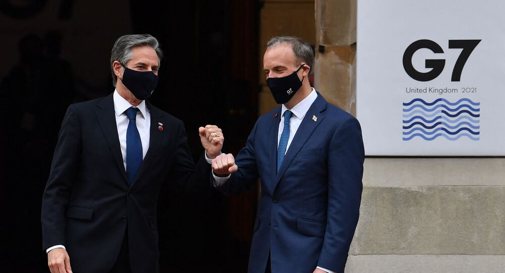 US Secretary of State Antony Blinken (L) is greeted on arrival by Britain's Foreign Secretary Dominic Raab at the start of the G7 foreign ministers meeting in London on May 4, 2021