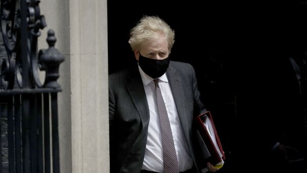 British Prime Minister Boris Johnson leaves 10 Downing Street in London, to attend the weekly Prime Minister's Questions at the Houses of Parliament, in London, Wednesday, April 21, 2021.  - Sputnik International