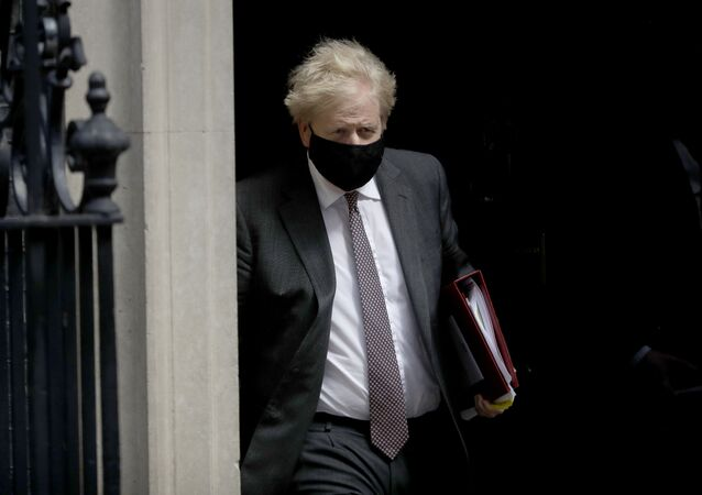 British Prime Minister Boris Johnson leaves 10 Downing Street in London, to attend the weekly Prime Minister's Questions at the Houses of Parliament, in London, Wednesday, April 21, 2021.