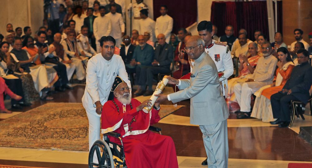Indian President Ram Nath Kovind (R) confers the Padma Bhushan award to Dr. Philipose Mar Chrysostom, one of the senior most bishop of the Malankara Mar Thoma Syrian Church, during an event at the presidential palace in New Delhi on March 20, 2018.