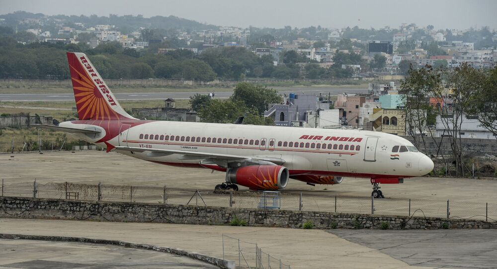 A security personnel stands guard near an Air India Airbus A-320  displayed at Begumpet Airport in Hyderabad on March 14, 2020.