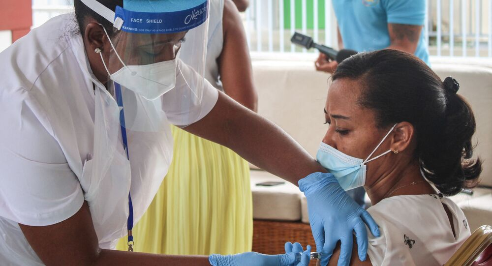 A medical personel injects the first dose of the Chinese Covid-19 vaccine produced by Sinopharm at the Seychelles Hospital in Victoria, on January 10, 2021.