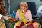 Lilaben Gautambhai Modi, 80, wearing an oxygen mask, sits inside an ambulance as she waits to enter a COVID-19 hospital for treatment, amidst the spread of the coronavirus disease (COVID-19), in Ahmedabad, India, May 5, 2021.