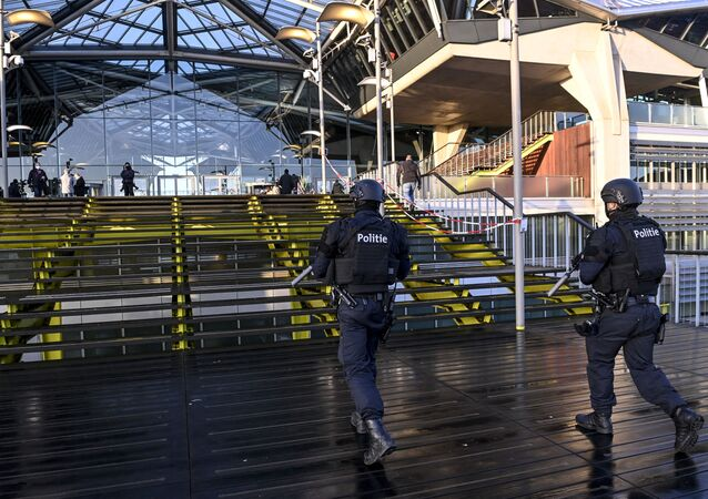 Heavily armed policemen patroll outside the courthouse during the trial of four persons including an Iranian diplomate and Belgian-Iranian couple before the Antwerp criminal court in Antwerp, on February 4, 2021. - A Belgian court returns a verdict on February 4, 2021, in the trial of an Iranian diplomat accused of plotting a bomb attack against opposition activists meeting in France. Assadollah Assadi, a 49-year-old formerly based in Vienna, faces up to 20 years in prison if convicted of plotting to target the June 30, 2018 rally. The gathering in Villepinte outside Paris included senior leaders of the exiled National Council of Resistance in Iran (NCRI) and some high-profile supporters.