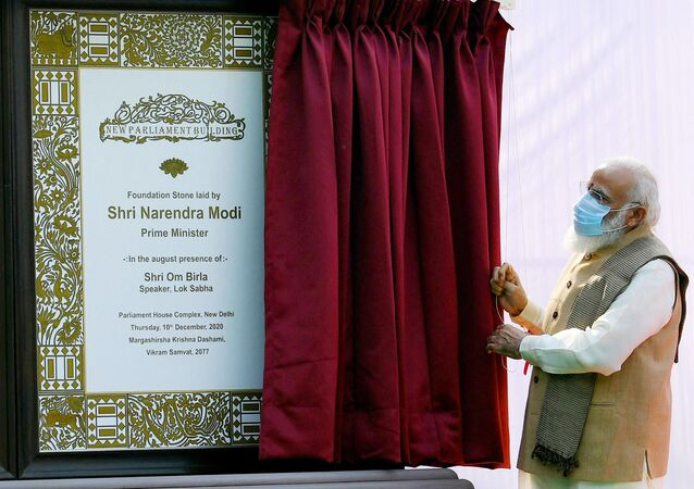 This handout photograph taken on December 10, 2020 and released by the Indian Press Information Bureau (PIB), shows India's Prime Minister Narendra Modi unveiling the plaque to lay the foundation stone of the new parliament building in New Delhi.