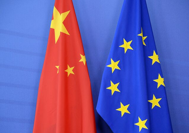 The Chinese flag(L) is draped beside the European Union (EU) during an EU- China Summit at the European Union Commission headquarters in Brussels on June 29, 2015