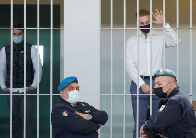 U.S. citizen Finnegan Lee Elder, accused of killing Carabinieri military police officer Mario Cerciello Rega, gestures as he waits next to Gabriel Natale-Hjorth for the start of a hearing as the verdict is expected to be announced, in Rome, Italy May 5, 2021.