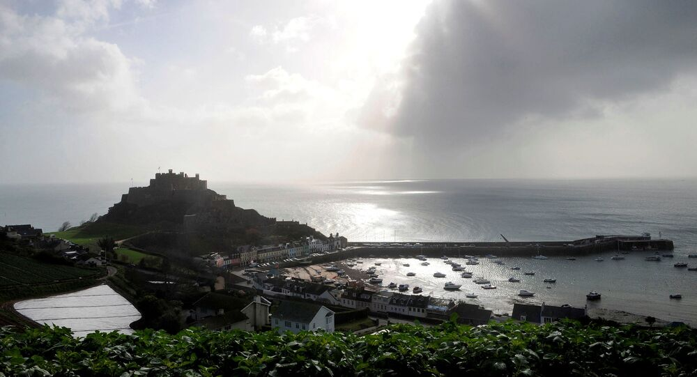FILE PHOTO: The village of Gorey Harbour and Mont Orgueil castle are seen in Jersey in this March 1, 2008 file photo.
