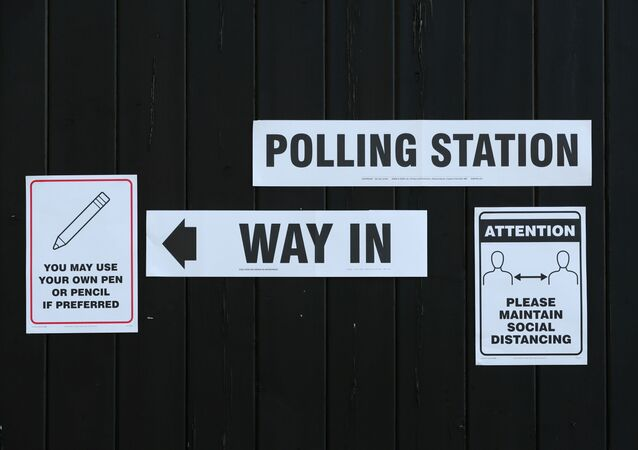 Signs pointing the way to a polling station and advising voters to maintain social distancing are seen at Fulwell Mill ahead of local elections, amid the coronavirus disease (COVID-19) pandemic, in Sunderland, Britain May 6, 2021.