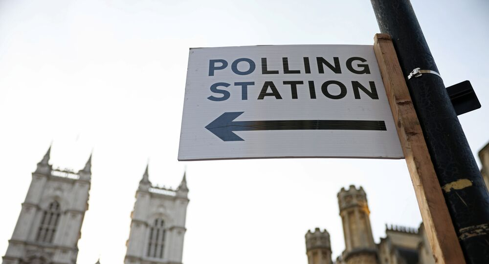 A polling station sign is seen in Westminster, London, Britain May 6, 2021.