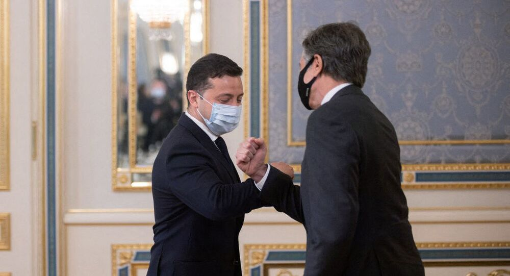 This handout photograph taken and released by the Ukrainian Presidential Press Service on May 6, 2021, shows Ukrainian President Volodymyr Zelensky (L) welcoming US Secretary of State Antony Blinken prior to their talks in Kiev.