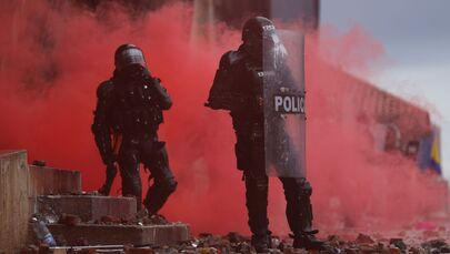 Police officers are seen during a protest against poverty and police violence in Bogota, Colombia, 5 May 2021.