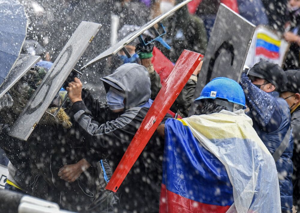 Demonstrators clash with riot police during a protest against President Ivan Duque's government on Bolivar Square in Bogota on 5 May 2021.