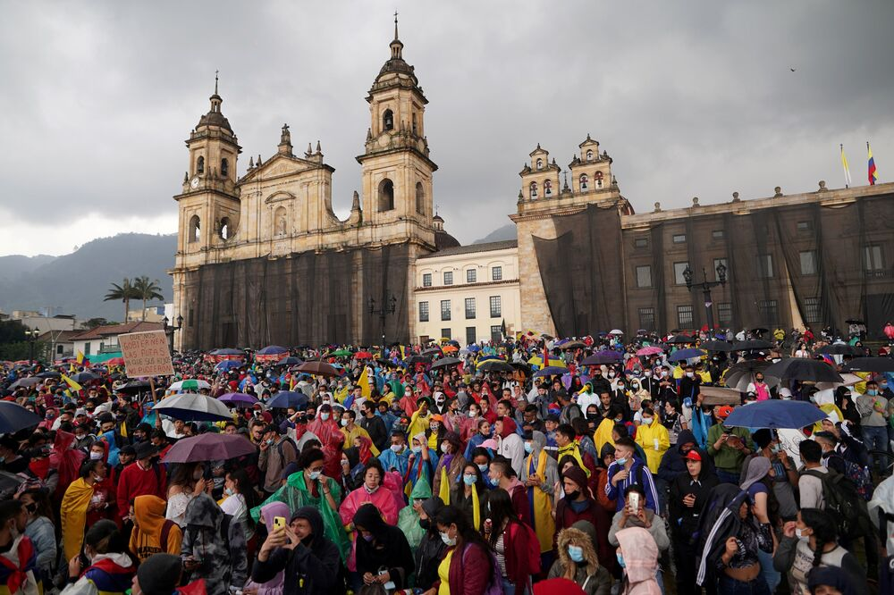 Demonstrators participate in a protest against poverty and police violence in Bogota, Colombia, 5 May 2021.