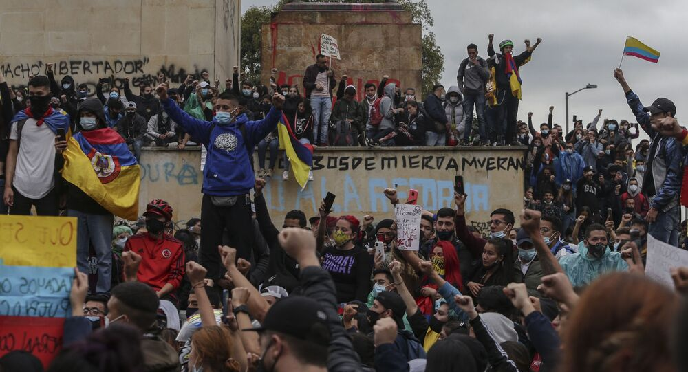 Anti-government demonstrators protest in Bogota, Colombia, Wednesday, May 5, 2021. The protests that began last week over a tax reform proposal continue despite President Ivan Duque's withdrawal of the tax plan on Sunday, May 2.