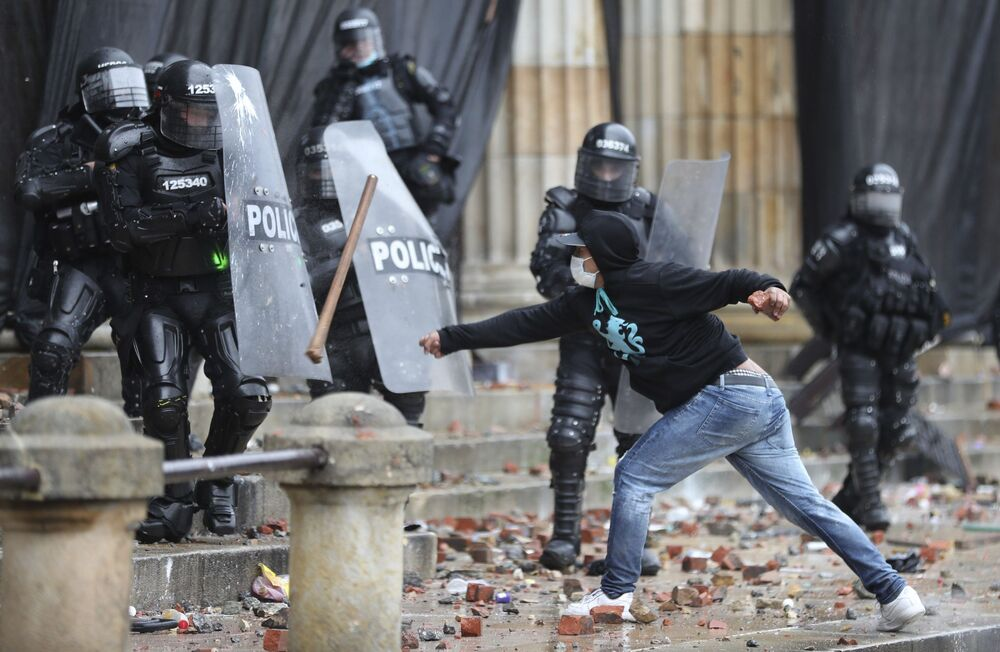 An anti-government protester clashes with police in Bogota, Colombia, Wednesday, 5 May 2021.