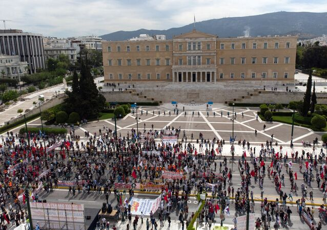 Members of the Greek Labour Union (PAME) protests past the Hellenic Parliament during a strike against the new Labour law, in central Athens on May 6, 2021.
