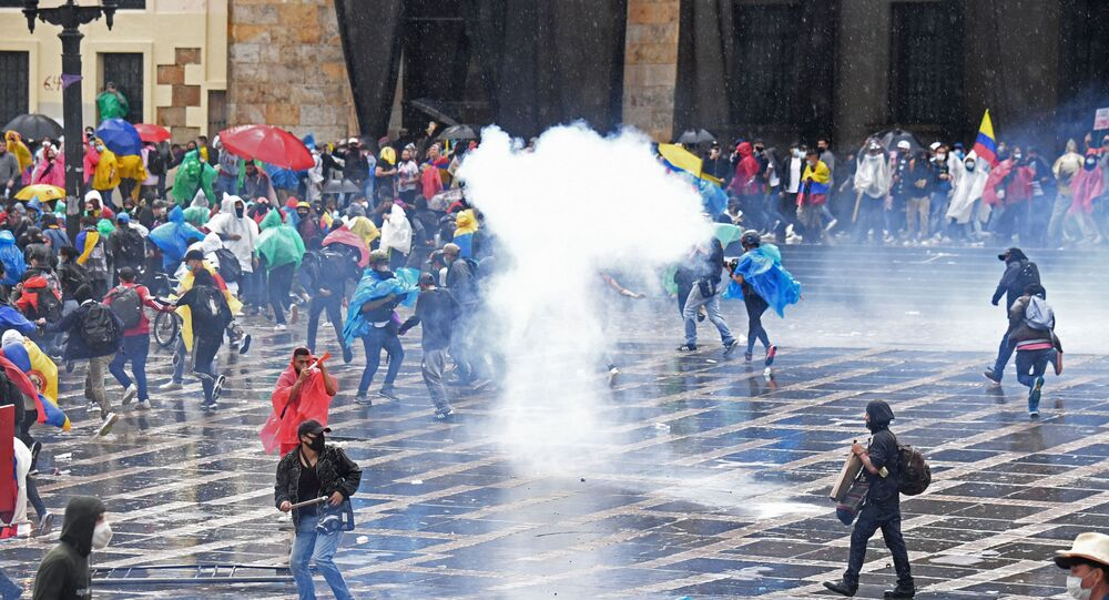 Demonstrators clash with riot police during a protest against President Ivan Duque's government at Plaza de Bolivar in Bogota on 5 May 2021.