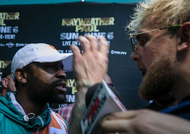 Floyd Mayweather (L) and Jake Paul confront each other during a press conference at Hard Rock Stadium, in Miami Gardens, Florida, on May 6, 2021. - Former world welterweight king Floyd Mayweather said May 4,2021 he will face off against YouTube personality Logan Paul in an exhibition bout at Miami's Hard Rock Stadium on June 6, 2021.