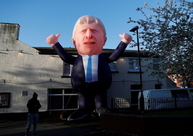 An inflatable figure of Prime Minister Boris Johnson is seen outside Mill House Leisure Centre as ballots are being counted, in Hartlepool, Britain May 7, 2021