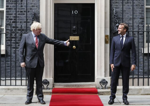 British Prime Minister Boris Johnson, left, meets with French President Emmanuel Macron at 10 Downing Street in London, Thursday, June 18, 2020. The President of the French Republic visits London to celebrate the 80th Anniversary of General de Gaulle's 'Appel' to the French population to resist the German occupation of France during WWII.
