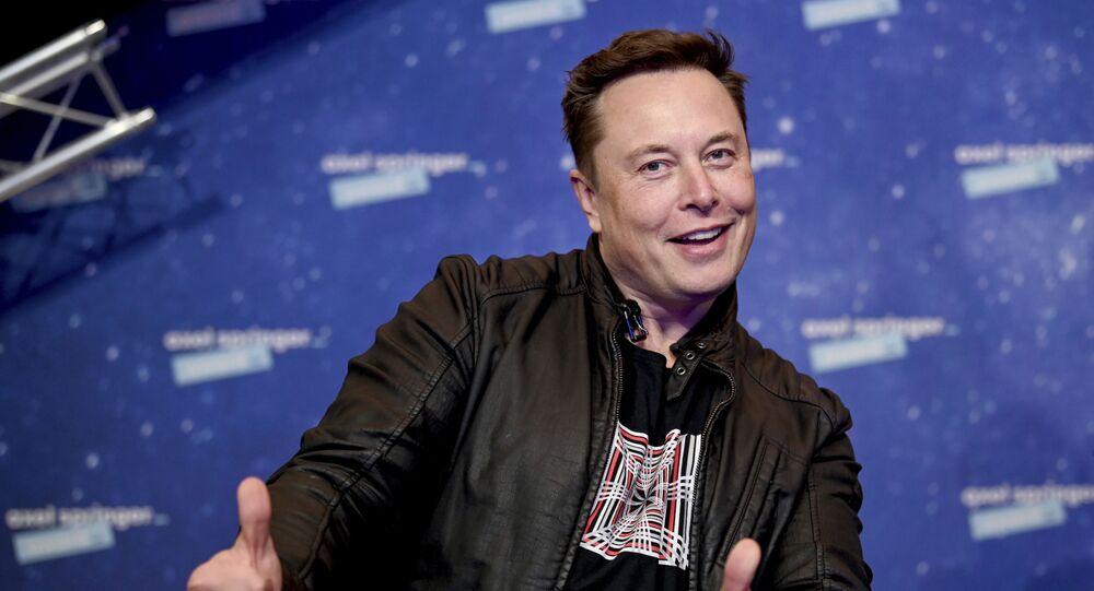 In this Tuesday, 1 December 2020 file photo, SpaceX owner and Tesla CEO Elon Musk arrives on the red carpet for the Axel Springer media award, in Berlin, Germany