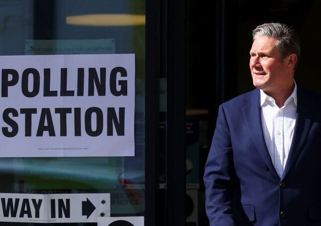 Labour Party leader Keir Starmer leaves a polling station after casting a vote during local elections on 6 May 2021.