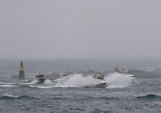 French fishing boats leave the Jersey waters following their protest in front of the port of Saint Helier off the British island of Jersey to draw attention to what they see as unfair restrictions on their ability to fish in UK waters after Brexit, on May 6, 2021.