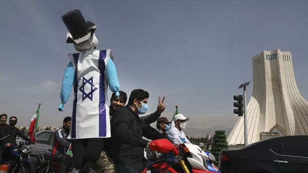 A demonstrator on a motorcycle holds an effigy representing Israel and the United States  during the annual Al-Quds, or Jerusalem, Day rally, with the Azadi (Freedom) monument tower seen at right, in Tehran, Iran, Friday, May 7, 2021. - Sputnik International