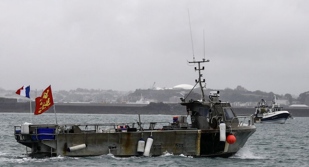 A French fishing boat, one of several, takes part in a protest in front of the port of Saint Helier off the British island of Jersey to draw attention to what they see as unfair restrictions on their ability to fish in UK waters after Brexit, on May 6, 2021. -
