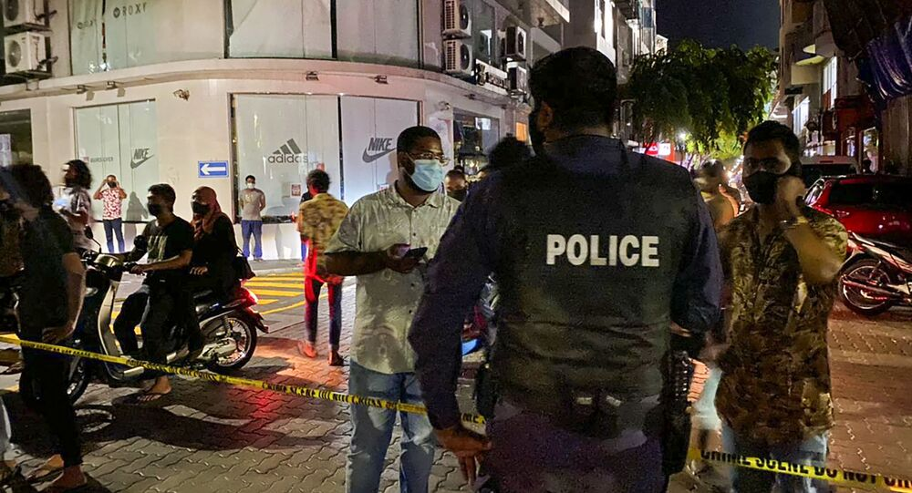 Police secure a site after a suspected bomb blast injured former Maldives president and current parliament speaker Mohamed Nasheed in Male on May 6, 2021.