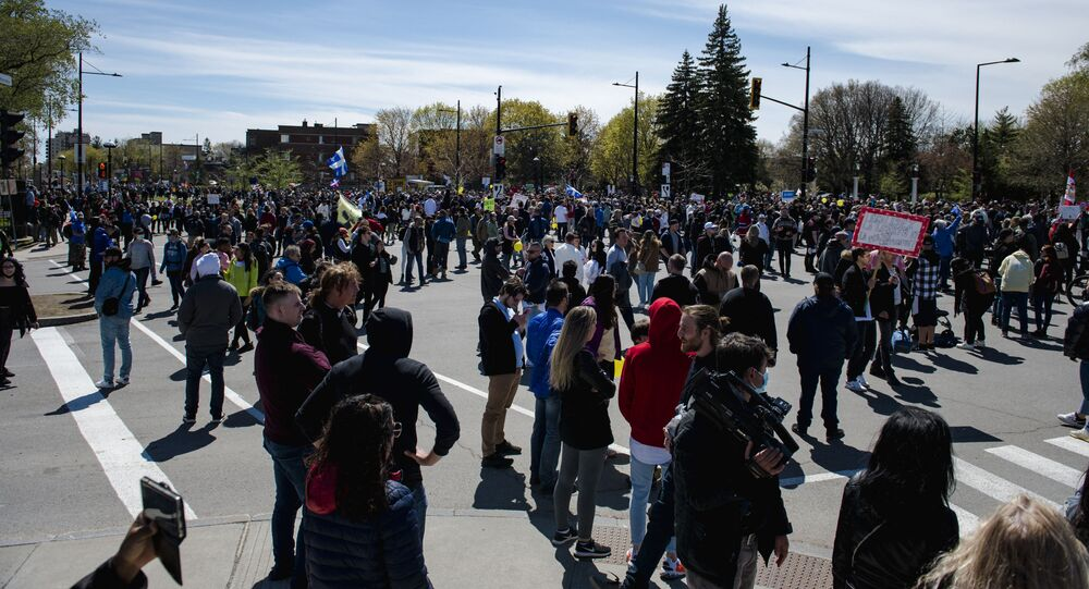 Demonstrators end their march against new Covid-19 anti-mask and anti-curfew restrictions, in Montreal on May 1, 2021.