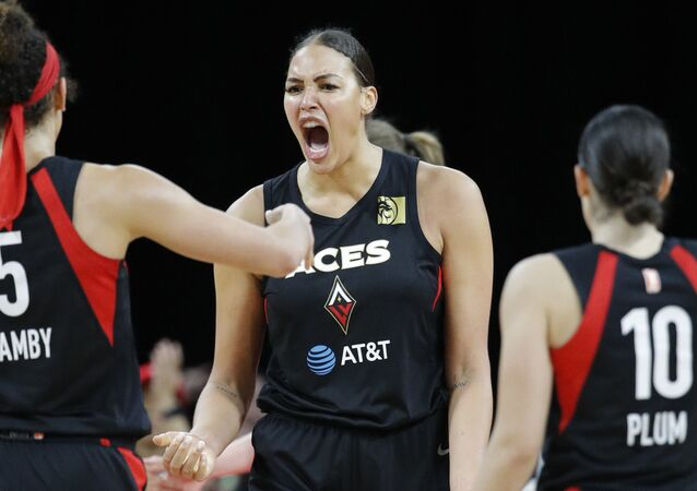 In this Sept. 24, 2019, file photo, Las Vegas Aces' Liz Cambage, center, celebrates after a play against the Washington Mystics during the second half of Game 4 of a WNBA playoff basketball series in Las Vegas