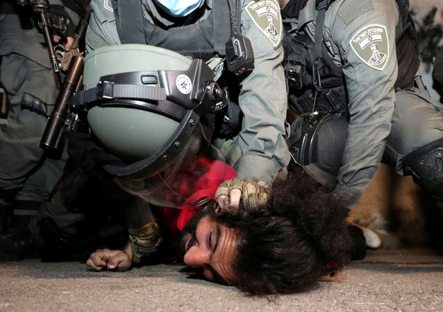 A Palestinian protester is detained by Israeli border policemen during clashes amid ongoing tension ahead of an upcoming court hearing in an Israeli-Palestinian land-ownership dispute in the Sheikh Jarrah neighbourhood of East Jerusalem May 4, 2021