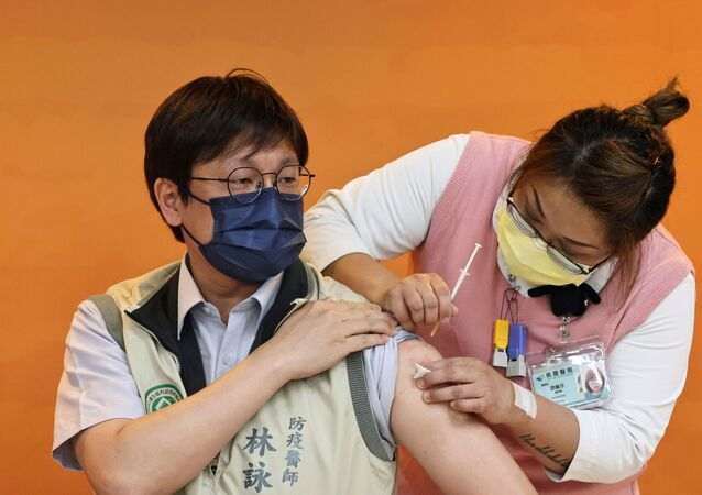 A doctor receives a dose of the AstraZeneca vaccine against the coronavirus in Taoyuan, Taiwan, April 12, 2021