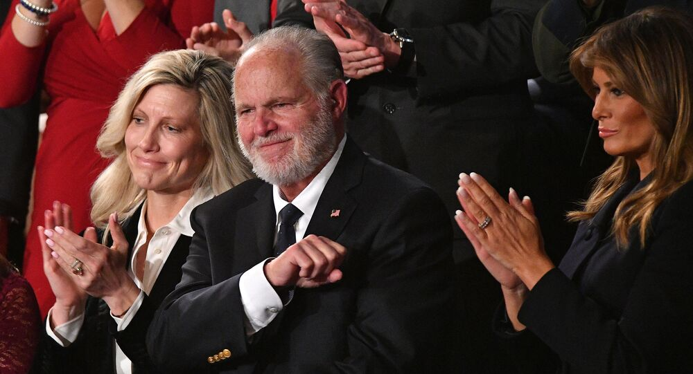 Radio personality Rush Limbaugh pumps his fist as he is acknowledged by US President Donald Trump as he delivers the State of the Union address at the US Capitol in Washington, DC, on February 4, 2020.