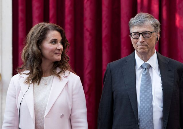 Philanthropist and co-founder of Microsoft Bill Gates (R) and his wife Melinda listen to a speech by French President Francois Hollande, prior to being awarded Commanders of the Legion of Honor at the Elysee Palace in Paris, France, 21 April 2017