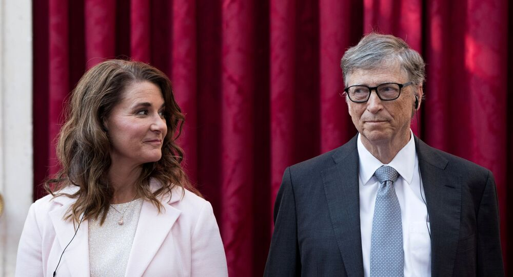 Philanthropist and co-founder of Microsoft Bill Gates and his wife Melinda listen to a speech by French President Francois Hollande prior to being awarded Commanders of the Legion of Honor at the Elysee Palace in Paris France 21 April 2017