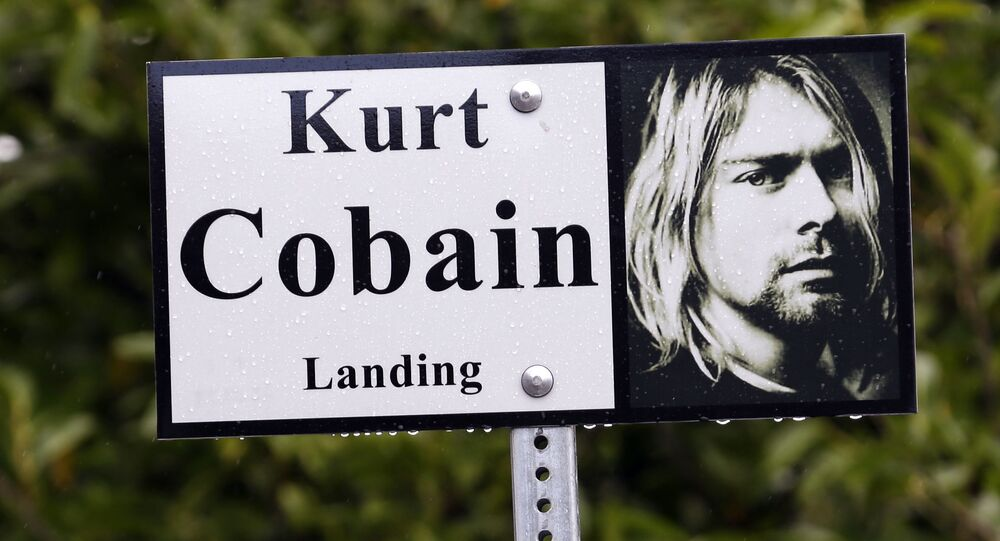 In this photo taken 23 September 2013, a sign marks the location of Kurt Cobain Landing, a tiny park blocks from the childhood home of Kurt Cobain, the late frontman of Nirvana, in Aberdeen, Washington.