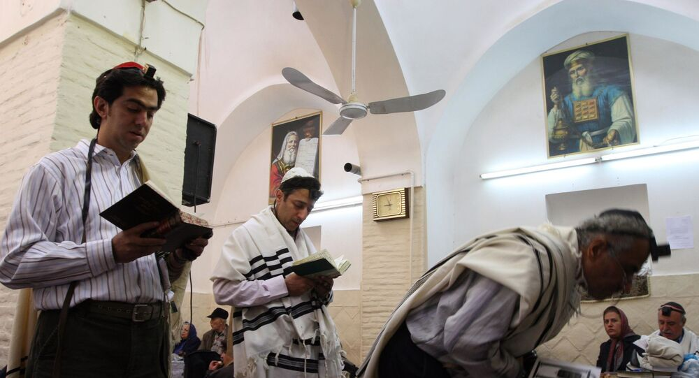 Standing under pictures of the Jewish Prophet Moses, Iranian Jewish men pray in a synagogue as they attend  a ceremony to commemorate Rabbi Harav Orsharga, a descendent of King David who died two centuries ago, in Yazd (670 km, 410 miles) south of Tehran, Iran, on 8 November 2007.
