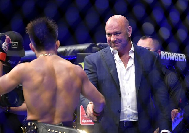 UFC President Dana White (R) congratulates Henry Cejudo (L) of the United States after defeating Dominick Cruz of the United States in their bantamweight title fight during UFC 249 at VyStar Veterans Memorial Arena on May 09, 2020 in Jacksonville, Florida.