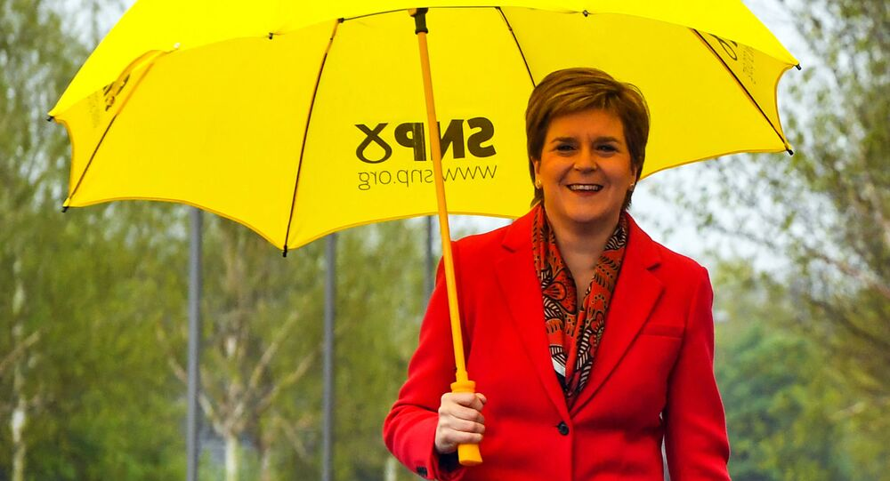 Scotland's First Minister and leader of the Scottish National Party (SNP), Nicola Sturgeon gestures on congratulating candidate Kaukab Stewart after she was elected MSP for Glasgow Kelvin in the Scottish Parliamentary Election, in Glasgow on May 8, 2021.