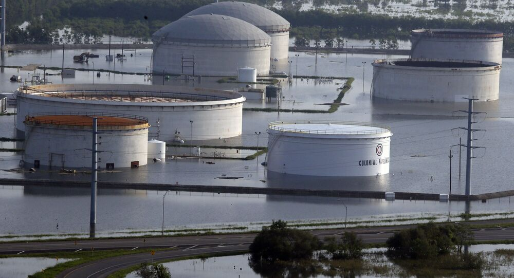 In this aerial photo, holding tanks for Colonial Pipeline Company sit in floodwaters caused Tropical Storm Harvey in Port Arthur, Texas, Friday, Sept. 1, 2017.