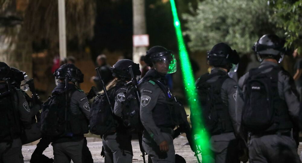 Israeli police gather during clashes with Palestinians at the compound that houses Al-Aqsa Mosque, known to Muslims as Noble Sanctuary and to Jews as Temple Mount, amid tension over the possible eviction of several Palestinian families from homes on land claimed by Jewish settlers in the Sheikh Jarrah neighbourhood, in Jerusalem's Old City, May 7, 2021.