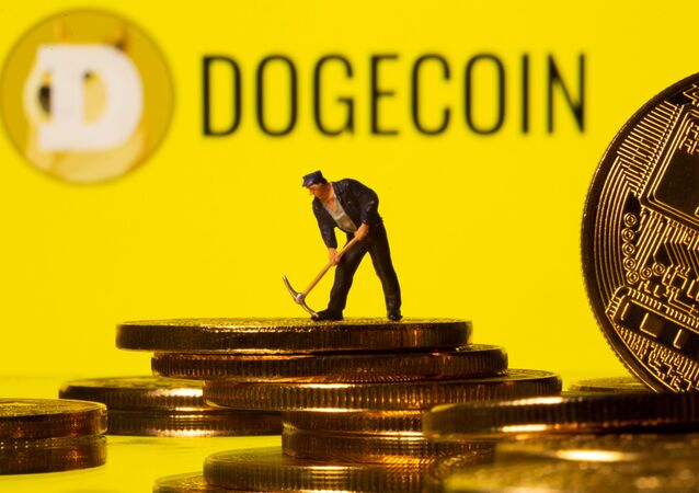 A small toy figure is seen on the cryptocurrency representation with Dogecoin logo in the background in this illustration picture taken, April 20, 2021