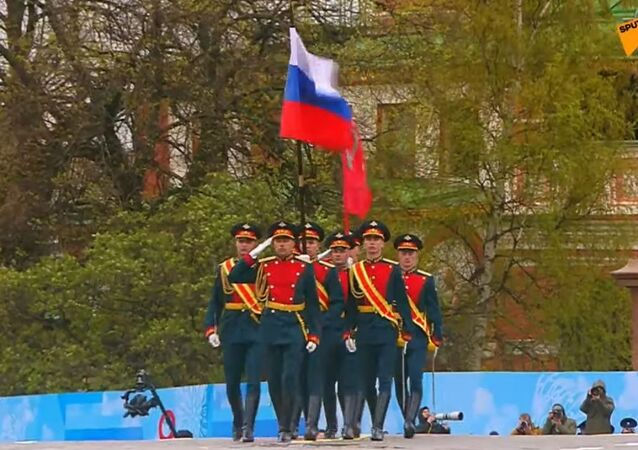 Russia's national flag and the legendary Banner of Victory are brought onto Red Square.