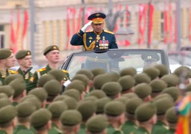 As tradition dictates, Defence Minister Sergei Shoigu heads toward the center of Red Square to inspect the troops.
