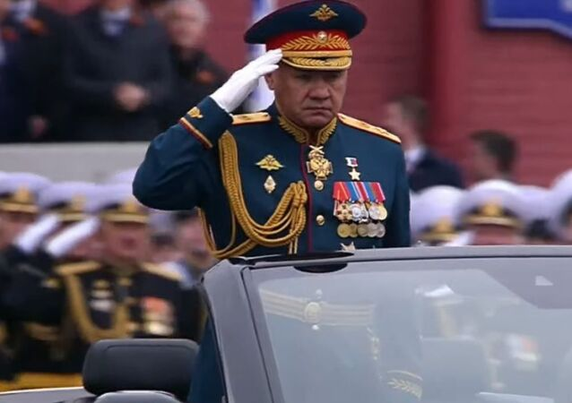 Defence Minister Sergei Shoigu heads toward the center of Red Square to inspect the troops.