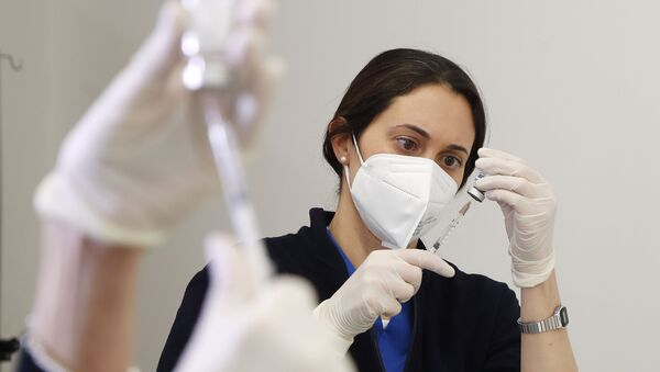 A medical worker prepares a dose of Russia's Sputnik V vaccine for COVID-19, at the San Marino State Hospital, in San Marino, Friday, April 9, 2021 - Sputnik International