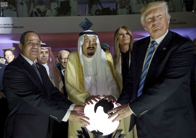 In this image from 21 May 2017, US President Donald Trump, Egyptian President Abdel Fattah el-Sisi, and Saudi King Salman, grasp an orb during a forum in Riyadh.